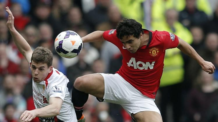 Manchester United's Rafael challenges Liverpool's Flanagan during their English Premier League soccer match in Manchester