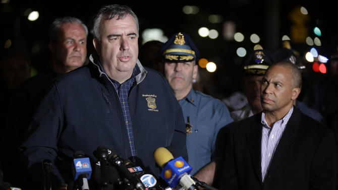 Boston Police Commissioner Ed Davis, at podium, speaks while accompanied by State Police Col. Timothy Alben, second from right, and Massachusetts Governor Deval Patrick, right, during a news conference, after the arrest of a suspect of the Boston Marathon bombings in Watertown, Mass., Friday, April 19, 2013. A 19-year-old college student wanted in the Boston Marathon bombings was taken into custody Friday evening after a manhunt that left the city virtually paralyzed and his older brother and accomplice dead.  (AP Photo/Matt Rourke)