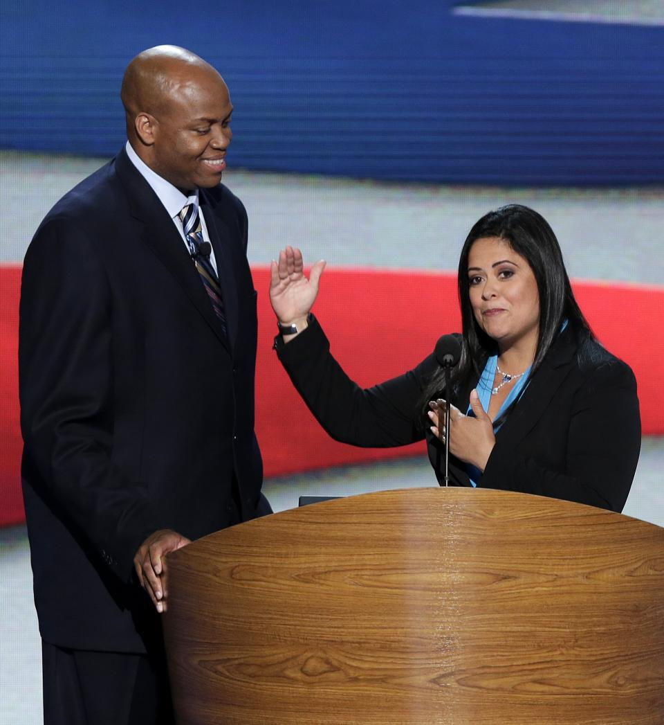 Maya Soetoro-ng, President Barack Obama's sister, right, and Craig Robinson, First Lady Michelle Obama's brother address the Democratic National Convention in Charlotte, N.C., on Tuesday, Sept. 4, 2012. (AP Photo/J. Scott Applewhite)