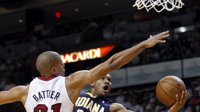 Indiana Pacers guard Leandro Barbosa (28) shoots against Miami Heat forward Shane Battier (31) during the first half of Game 1 in an NBA basketball Eastern Conference semifinal playoff series, Sunday, April 13, 2012, in Miami. (AP Photo/Wilfredo Lee)