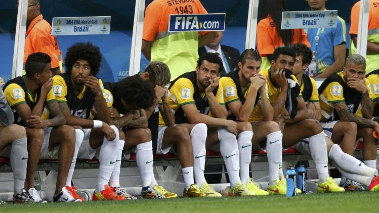 Brazil's Neymar and teammates react after Netherlands' third goal during the 2014 World Cup third-place playoff between Brazil and the Netherlands at the Brasilia national stadium
