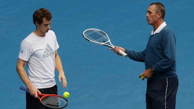Britain's Andy Murray, left, listens as his coach Ivan Lendl gestures during a training session on Rod Laver Arena at the Australian Open tennis championship in Melbourne, Australia, Saturday, Jan. 26, 2013. Murray will play Serbia's Novak Djokovic in the final on Sunday.  (AP Photo/Dita Alangkara)
