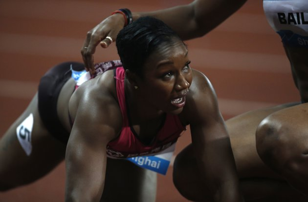 Jeter of the U.S. grimaces after being injured during women's 100m race at the IAAF Diamond League Athletics meet in Shanghai