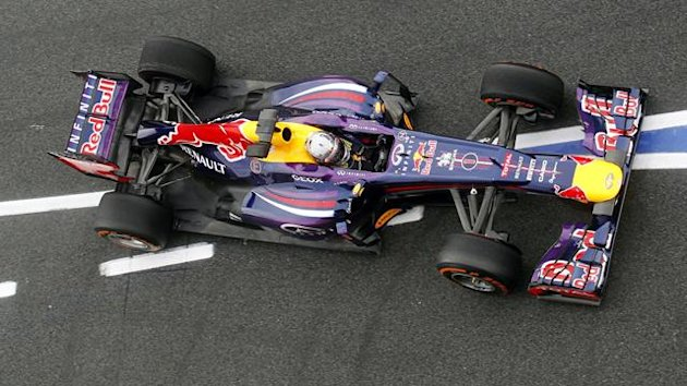 Red Bull Formula One driver Sebastian Vettel of Germany drives during the first free training session at the Spanish Grand Prix at the Circuit de Catalunya in Montmelo, near Barcelona May 10, 2013 (Reuters)