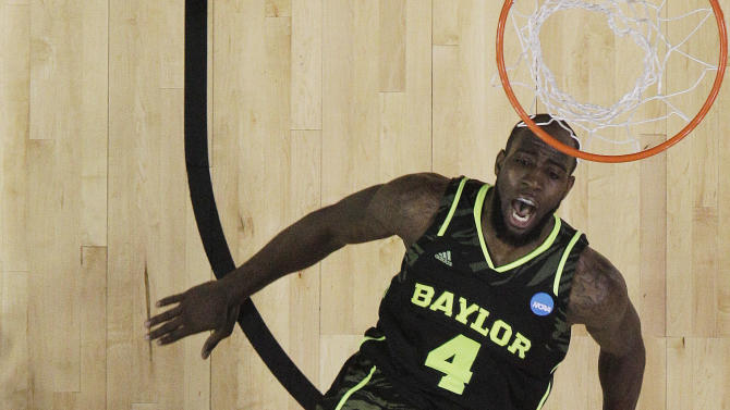 Kentucky's Marquis Teague (25) shoots over Baylor's Quincy Acy (4) during the first half of an NCAA tournament South Regional finals college basketball game Sunday, March 25, 2012, in Atlanta. (AP Photo/David J. Phillip)