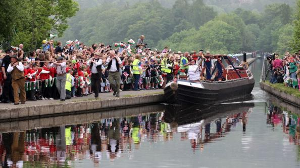 Joanne Gregory, Torchbearer 024, travels by barge across the Pontcysyllte Aqueduct with the Olympic Flame during the leg between Wrexham and Trevor in North Wales on day 12 of the London 2012 Olympic Torch Relay on May 30, 2012 in Wales. The Olympic Flame is now on day 12 of a 70-day relay involving 8,000 torchbearers covering 8,000 miles. (Photo by LOCOG via Getty Images)