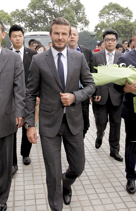 In this photo provided by China's Xinhua News Agency, David Beckham arrives in Shanghai, east China, Wednesday, June 19, 2013.   Beckham is on a seven-day visit to China, and will attend a Chinese Sup