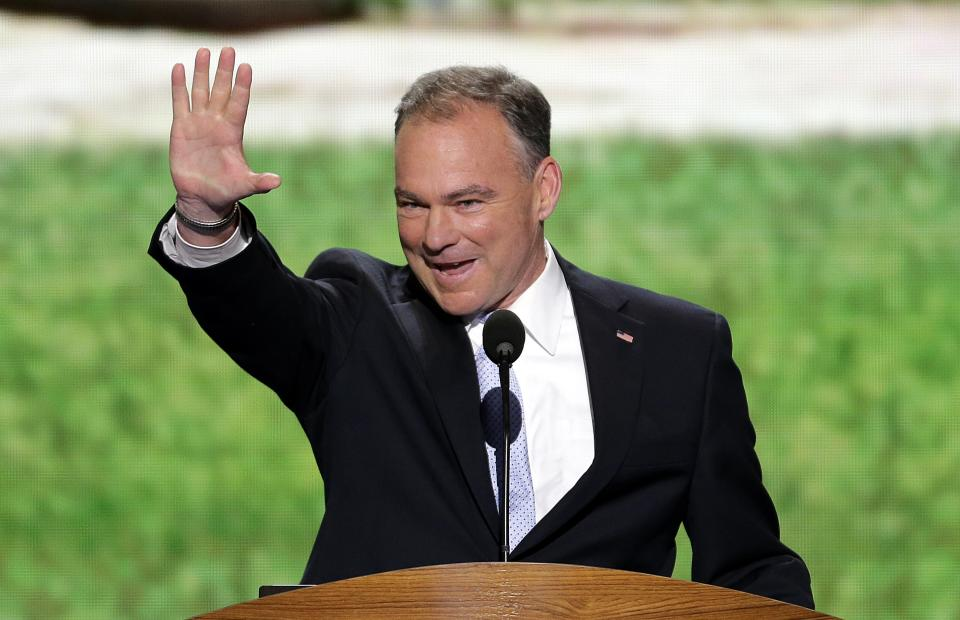 FILE - In this Sept. 4, 2012, file photo, former Virginia Gov. Tim Kaine waves to the delegates from Virginia before addressing the Democratic National Convention in Charlotte, N.C. (AP Photo/J. Scott Applewhite, File)