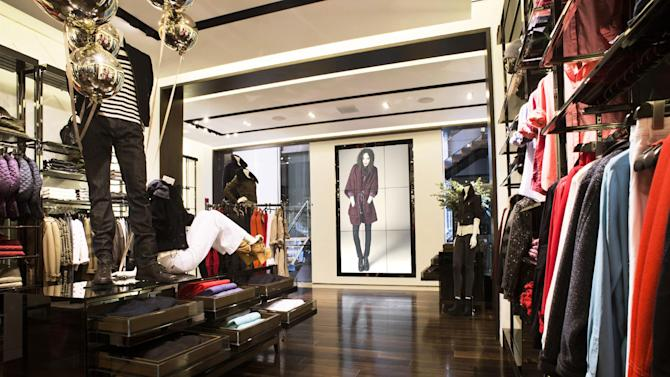 This undated publicity photo provided by BURBERRY shows an interior of the BURBERRY BRIT section of the new BURBERRY Flagship store opened in November 2012 on Michigan Avenue in Chicago. BURBERRY has been known for generations for its signature check pattern and trenchcoat.  The company has monthly updates at Burberry.com, where CEO, Angela Ahrendts said, more people visit every week than walk into all the brand's stores around the world combined.   (AP Photo/BURBERRY)
