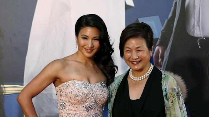 China-born actress Cheng Pei-pei and daughter Marsha Yuan pose on the red carpet upon arrival at Hong Kong Film Awards