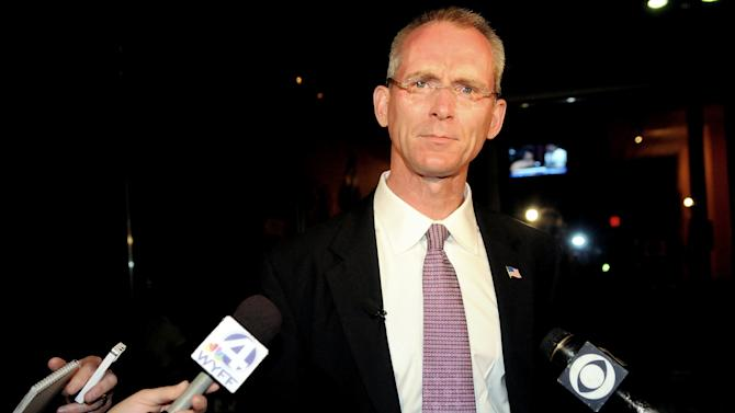 "FILE - In this Tuesday June 22, 2010 file photo, South Carolina congressional candidate Bob Inglis speaks to the reporters after his loss in the runoff election to Trey Gowdy in Greenville, S.C. A carbon tax has been revived by some on both right and left spectrum of politics and is suddenly the hot topic of opinion pieces and quiet discussions. ""I think the impossible may be moving to the inevitable without ever passing through the probable,"" said Inglis. The Republican lost his seat in 2010 in a primary fight, partly because acknowledged that global warming exists and needs to be dealt with. Now he heads a new group that advocates a carbon tax and the idea is endorsed by former Ronald Reagan economic adviser Arthur Laffer. (AP Photo/ Richard Shiro)"