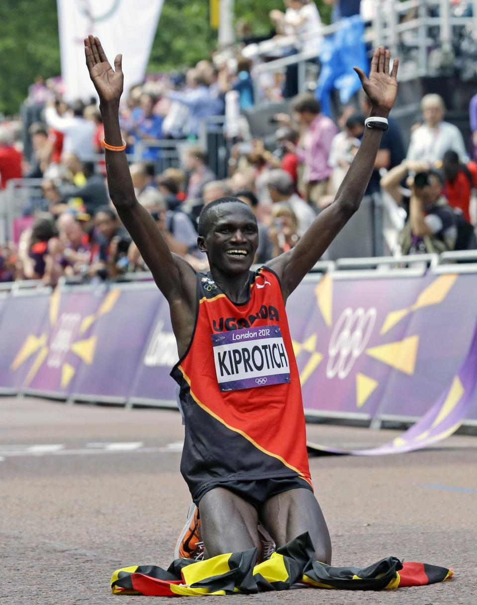 Stephen Kiprotich of Uganda celebrates after winning the men's marathon at the 2012 Summer Olympics in London, Sunday, Aug. 12, 2012. (AP Photo/Luca Bruno)