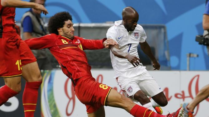 Belgium's Fellaini fights for the ball with Beasley of the U.S. during their 2014 World Cup round of 16 game at the Fonte Nova arena in Salvador