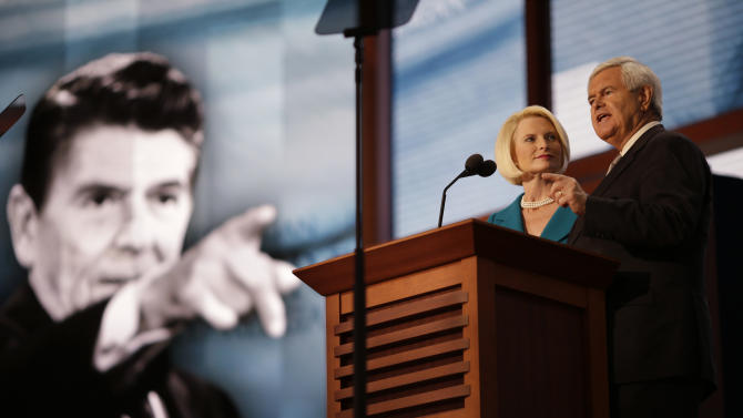 Former House Speaker Newt Gingrich and his wife Callista addresses the Republican National Convention in Tampa, Fla., on Thursday, Aug. 30, 2012. (AP Photo/David Goldman)