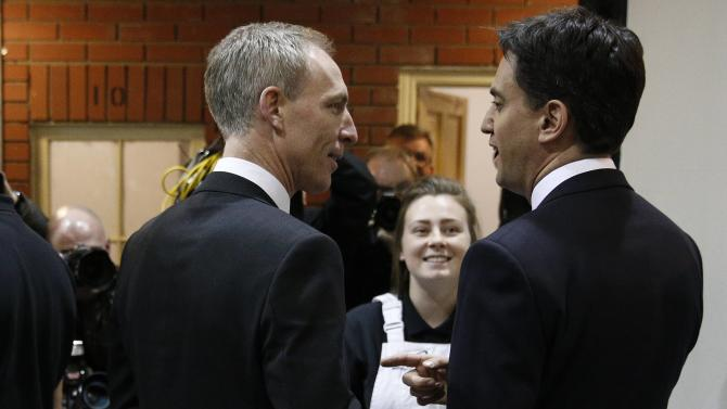 Britain's Labour Party leader Ed Miliband and Scottish Labour party leader Jim Murphy speak with apprentices as they visit Queenslie Training Centre in Glasgow