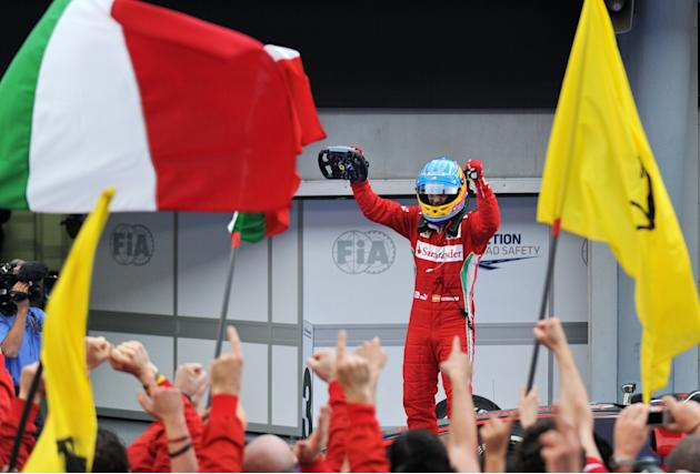 Ferrari driver Fernando Alonso of Spain celebrates after winning Formula One's Malaysian Grand Prix at the Sepang International Circuit in Sepang on March 25, 2012. TOPSHOTS  AFP PHOTO / ROSLAN RAHMAN