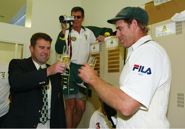 Matthew Hayden of Australia is congratulated by former Australian player Mark Taylor after scoring 380 to break Brian Lara of The West Indies world record of 375
