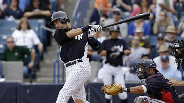 New York Yankees designated hitter Derek Jeter bats in a spring training baseball game against the Atlanta Braves at Steinbrenner Field in Tampa, Fla., Saturday, March 9, 2013. Braves catcher Gerald Laird is behind the plate. (AP Photo/Kathy Willens)