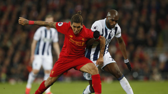 Liverpool's Roberto Firmino in action with West Bromwich Albion's Allan Nyom