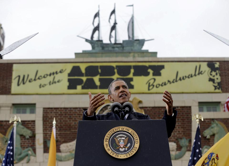 President Barack Obama gestures as he speak outside at Asbury Park Convention Hall ,Tuesday, May 28, 2013 in Asbury Park, New Jersey. Obama traveled to New Jersey to join New Jersey Gov. Chris Christie to inspect and tour the Jersey Shore's recovery efforts from Hurricane Sandy. (AP Photo/Pablo Martinez Monsivais)
