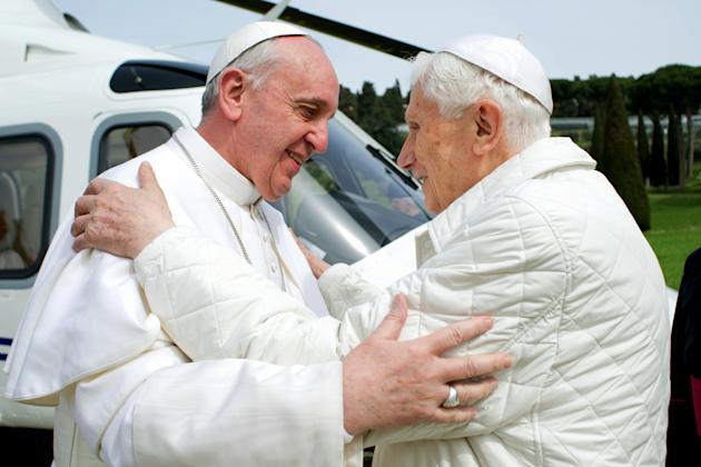 In this photo provided by the Vatican paper L'Osservatore Romano, Pope Francis meets Pope emeritus Benedict XVI in Castel Gandolfo Saturday, March 23, 2013. Pope Francis has traveled to Castel Gandolf