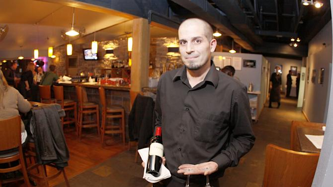 Patrick Bloomquist, 34, a server at Kinley's Restaurant in Anchorage Alaska says that he encouraged U.S. Sen. Lisa Murkowski to run on a write in only days after she was defeated by Joe Miller in the Alaska primary election. Bloomquist shown here in Kinley's Restaurant on Wednesday Nov. 17, 2010 in Anchorage received a thank you card from Murkowski for his encouragement. The restaurant server said that she also credited support from her family to run on a write-in. Murkowski accepted the Nov. 2010 election results Wednesday in Anchorage with more than 1,000 votes ahead of opponent Joe Miller. (AP Photo/Rob Stapleton)