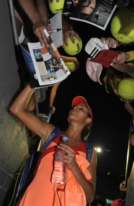 Ana Ivanovic Of Serbia Signs AFP/Getty Images