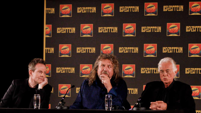 Led Zeppelin bassist and keyboardist John Paul Jones, from let, frontman Robert Plant and guitarist Jimmy Page appear at a media screening ahead of the worldwide theatrical release of Led Zeppelin's 2007 Celebration Day concert at the O2, on Friday, Sept. 21, 2012, in London. (Photo by Miles Willis/Invision/AP)