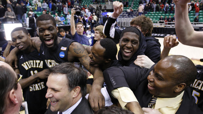 Wichita State players and coaches celebrate a 76-70 win over Gonzaga during a third-round game in the NCAA men's college basketball tournament in Salt Lake City on Saturday, March 23, 2013. (AP Photo/George Frey)