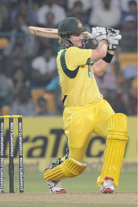 Australian player Shane Watson plays a shot during during the 7th ODI between India and Australia played at Chinnaswamy Stadium in Bangalore on Nov.2, 2013. (Photo: IANS)