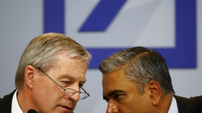 Jain and Fitschen, co-CEOs of Deutsche Bank, speak at a news conference in Frankfurt
