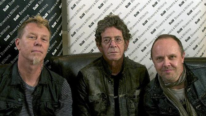 "In this Oct. 24, 2011 photo, Metallica members James Hetfield, left, and  Lars Ulrich, right, pose with musician Lou Reed in New York.  Metallica and Reed teamed up for Reed's latest release, ""Lulu."" Oscar-nominated director Darren Aronofsky will direct a music video from the new Metallica and Lou Reed album, ""Lulu."" (AP Photo/John Carucci)"