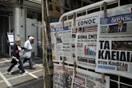 Newspapers featuring the political impasse are displayed at a kiosk in Athens May 11. Greece&#39;s president was set Saturday to call last-ditch talks in a bid to forge an emergency unity government and avoid fresh elections, after the main parties failed to form a working coalition