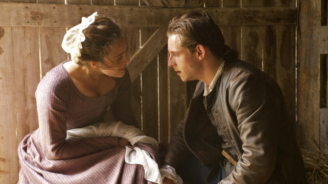 """This image released by AMC shows Heather Lind as Anna Strong, left, and Jamie Bell as Abe Woodhull in a scene from """"Turn,"""" premiering Sunday at 9 p.m. EST. (AP Photo/AMC, Antony Platt)"""