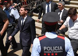 Lionel Messi (left) leaves court in Barcelona on June …