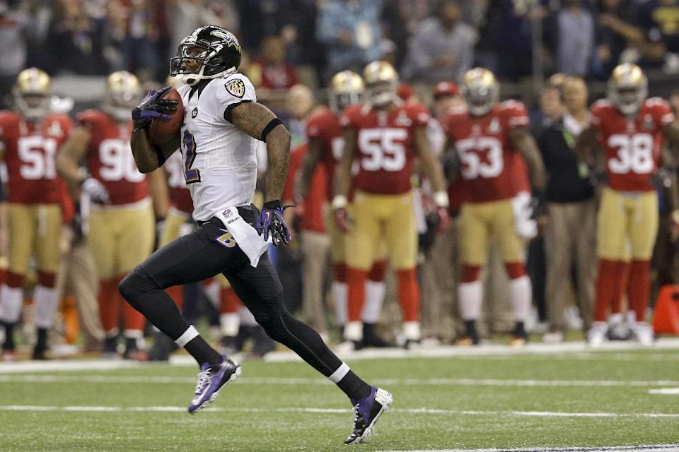 Baltimore Ravens wide receiver Jacoby Jones (12) runs the second-half opening kickoff back for a touchdown against the San Francisco 49ers in the NFL Super Bowl XLVII football game, Sunday, Feb. 3, 2013, in New Orleans. (AP Photo/Patrick Semansky)