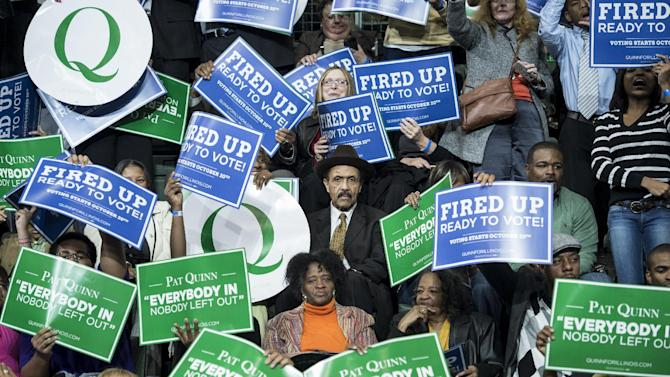 People wait for US President Barack Obama during a rally at Chicago State University October 19, 2014 in Chicago, Illinois