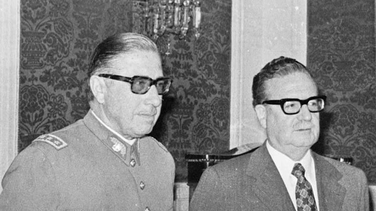 FILE - In this Aug. 23, 1973 file photo, Chile's Gen. Augusto Pinochet, left, and President Salvador Allende attend a ceremony naming Pinochet as commander in chief of the army in Santiago, Chile. Eighteen days later Pinochet took power in a coup in which Allende died.  The perseverance and persistence during the last two decades from the former driver and assistant of Chilean poet Pablo Neruda, who believes that the Pinochet dictatorship ordered the world-wide poet's assassination, prompted a human rights judge to order on Feb. 8, 2013 the exhumation of Neruda's body. But chances are that the exhumation won't be conclusive on whether the poet died in the middle of a treatment for prostate cancer or was killed by a doctor, whose existence no one can verify, to silence the vocal poet who was an active member of the Chilean Communist Party. Officially, Neruda died of cancer only days after the 1973 coup toppled his close friend, socialist President Salvador Allende.  (AP Photo, File)