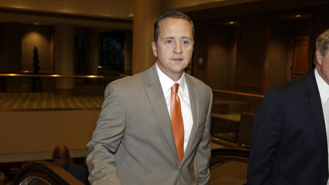 University of Miami Athletic Director Blake James walks to an NCAA Committee on Infractions hearing in Indianapolis, Thursday, June 13, 2013. The committee  is scheduled to open its hearings into allegations the University of Miami committed rules infractions in football and men's basketball. (AP Photo/Michael Conroy)