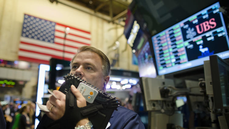 FILE - In this Oct. 26, 2012, file photo, trader F. Hill Creekmore works on the floor of the New York Stock Exchange, in New York. Stock futures are lower Monday, Nov. 5, 2012, in very light trading with many investors standing down a day before what could be one of the closest presidential elections in U.S. history.  (AP Photo/John Minchillo, File)