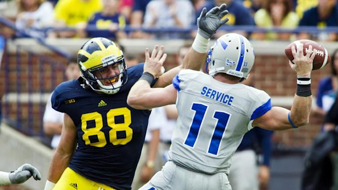 Michigan defensive end Craig Roh (88) pressures Air Force quarterback Connor Dietz (11) in the second quarter of an NCAA college football game, Saturday, Sept. 8, 2012, in Ann Arbor, Mich. (AP Photo/Tony Ding)