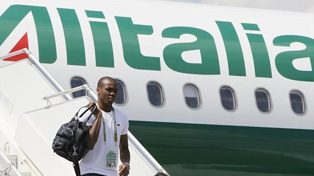 taly's national player Angelo Ogbonna disembarks from the team plane (Reuters)