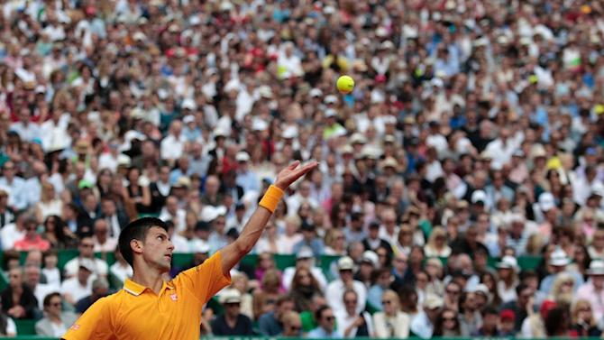 Serbian player Novak Djokovic serves to Spain's Rafael Nadal at the Monte-Carlo ATP Masters Series Tournament tennis match on April 18, 2015 in Monaco