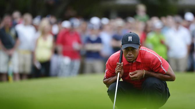 Tiger Woods lines up his putt on the second green during the final round of the Arnold Palmer Invitational golf tournament in Orlando, Fla., Sunday, March 24, 2013. (AP Photo/Phelan M. Ebenhack)