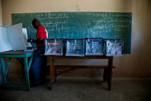A voter casts his ballot at a polling station in the…
