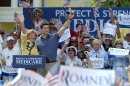 Republican vice-presidential candidate Rep. Paul Ryan, R-Wis., center left, and his mother Betty Ryan Douglas wave to supporters at a campaign rally in The Villages, Fla., Saturday, Aug. 18, 2012.(AP Photo/Phelan M. Ebenhack)