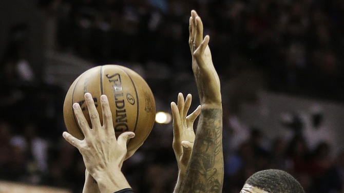 San Antonio Spurs' Danny Green (4) shoots over Miami Heat's Udonis Haslem (40) during the first half at Game 5 of the NBA Finals basketball series, Sunday, June 16, 2013, in San Antonio. (AP Photo/Eric Gay)