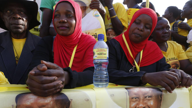 Supporters of Uganda's President and the presidential candidate Museveni attend his campaign rally in Entebbe