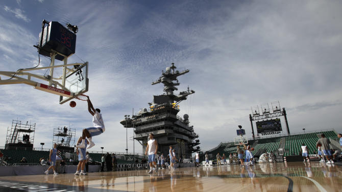 North Carolina forward Desmond Hubert, left, dunks during practice before the Carrier Classic NCAA college basketball game against Michigan State aboard the USS Carl Vinson, Friday, Nov. 11, 2011, in Coronado, Calif. (AP Photo/Gregory Bull)