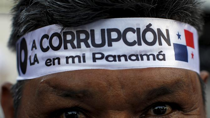A protester is seen with band on his head during an anti-corruption march in Panama
